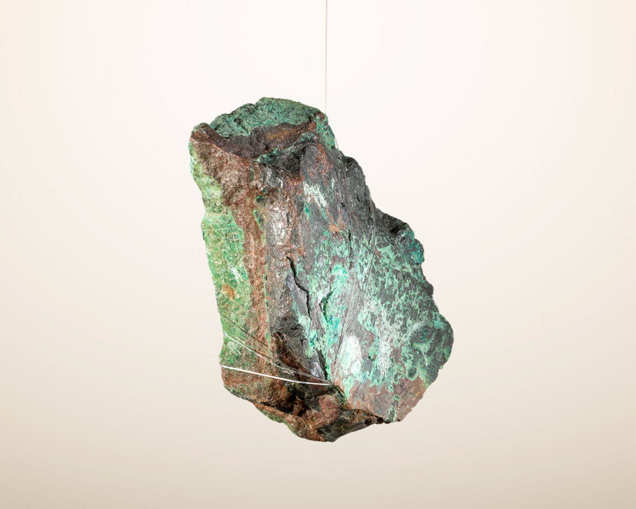 Copper ore hanging with a fishing wire. From 'Metallic Threads' (from 'Copper Geographies'), Brighton, 2015 © Ignacio Acosta