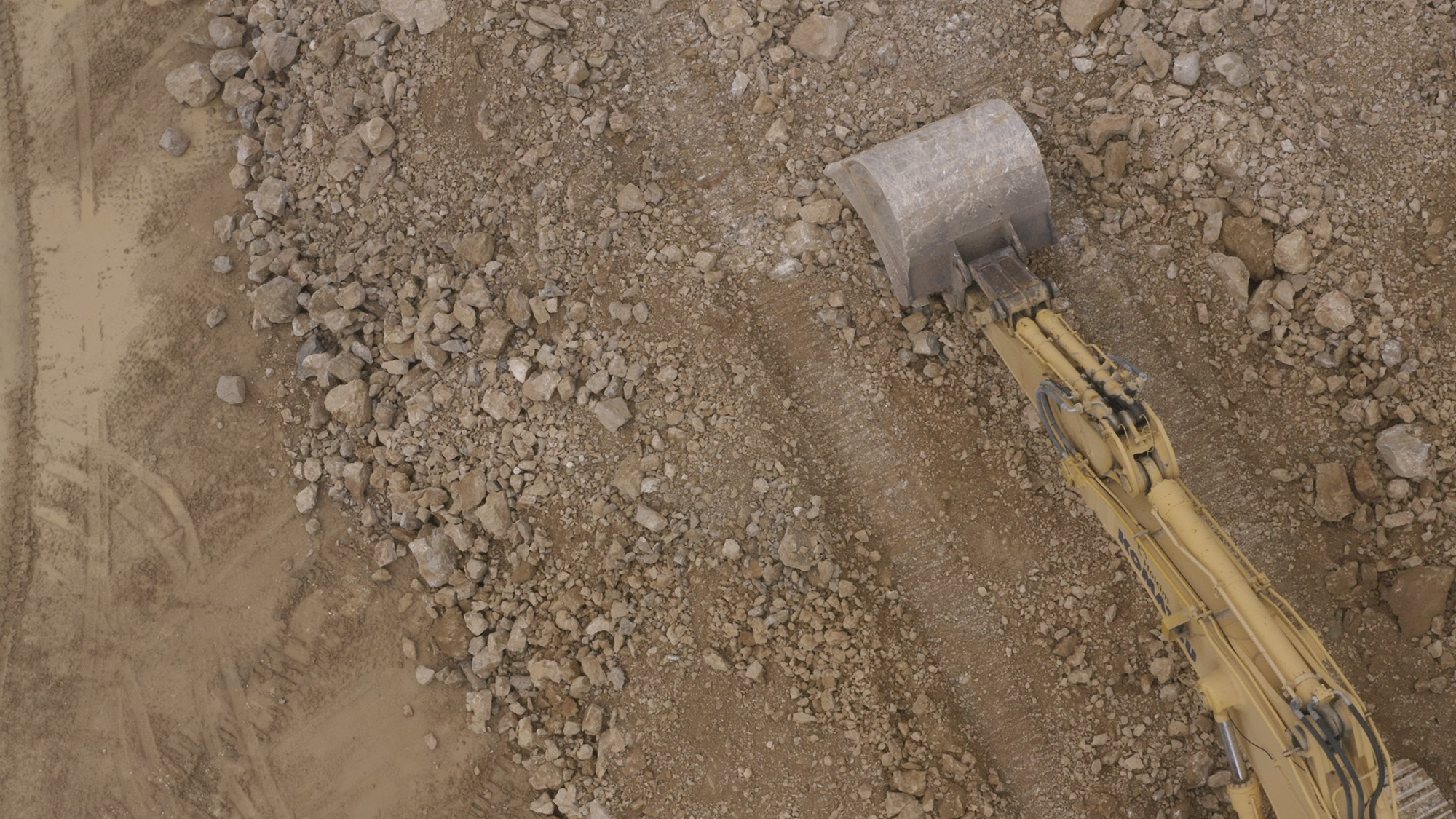 Drone view of an excavator at Le Mormont, Canton of Vaud, Switzerland, 2020